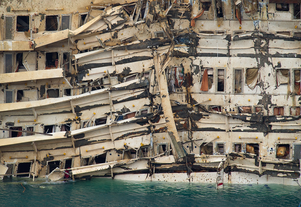 The parbuckling operation shifted the vessel upright, revealing severe damage.