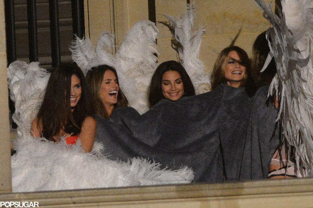 Adriana Lima, Alessandra Ambrosio, Lily Aldridge, and Behati Prinsloo tried to stay warm with a blanket.