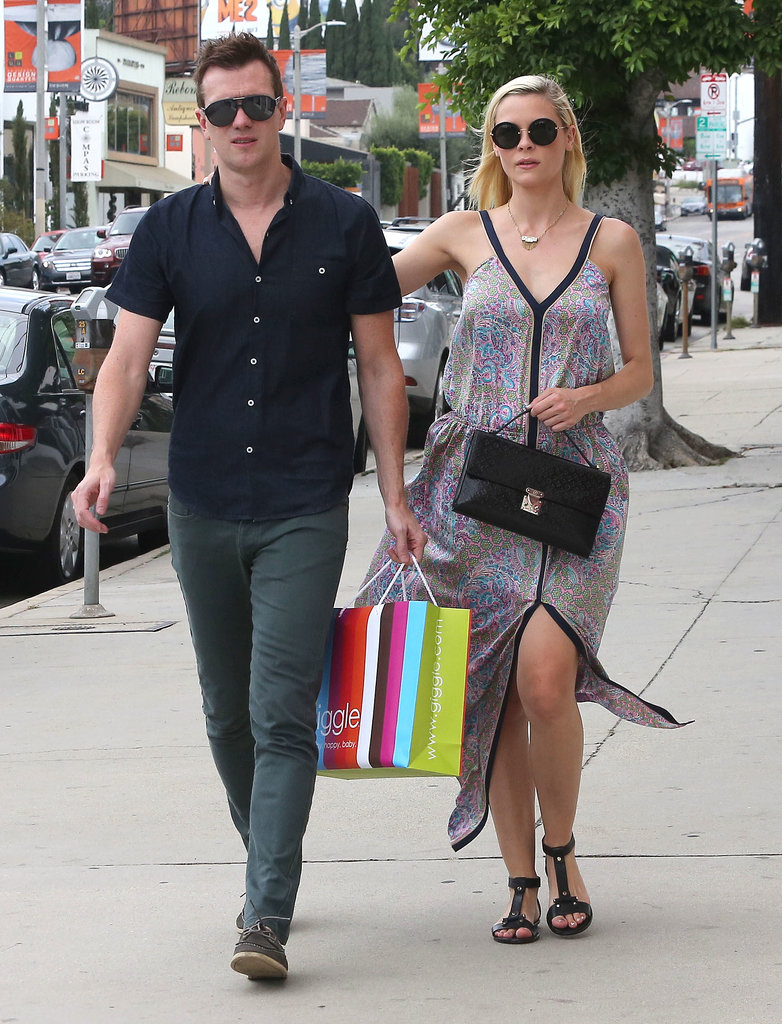 Jaime King donned a printed maxi dress while strolling West Hollywood with her husband. We especially dig the front slit, and all her cool black add-ons.