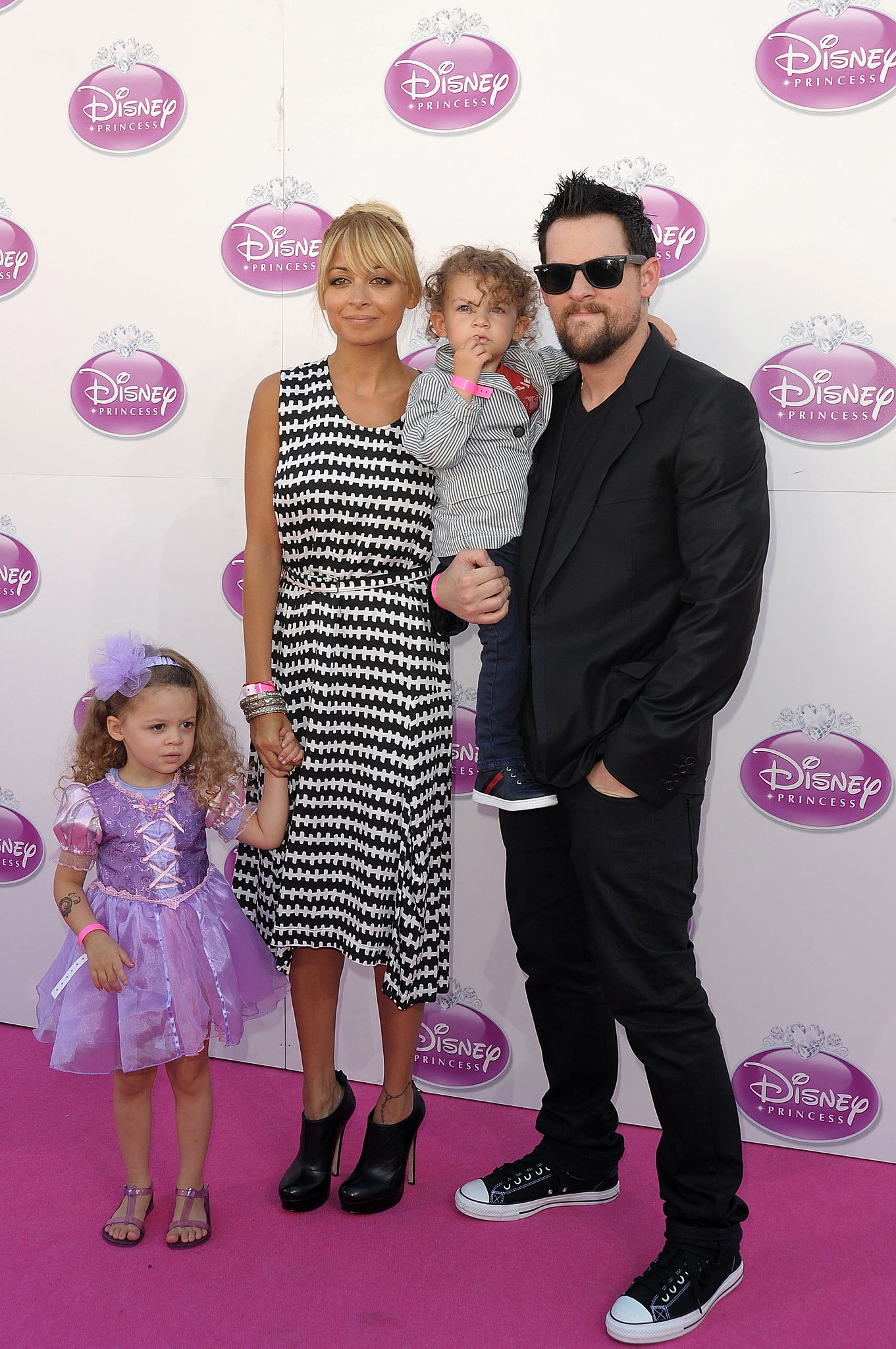 Nicole and Joel spent a fun family day with their little ones, Harlow and Sparrow, at a Disney event in London during October 2011.