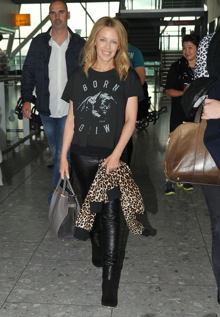 Kylie Minogue didn't let a little traveling keep her from looking rock 'n' roll in leather pants and leopard.