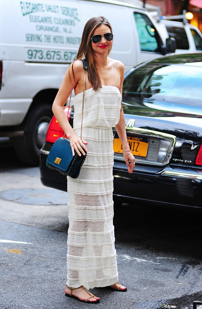 Miranda Kerr was feminine in a white lace maxi dress, but her studded Emilio Pucci bag and aviators added a hint of cool in NYC.