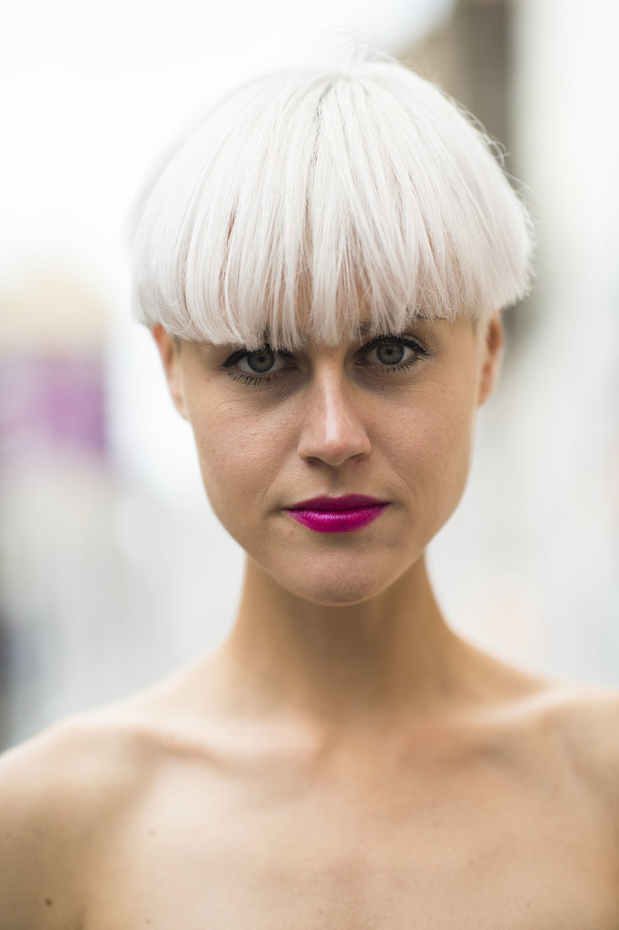 Neon pink lips and pure white hair give off a vaguely '80s vibe. Source: Le 21ème | Adam Katz Sinding