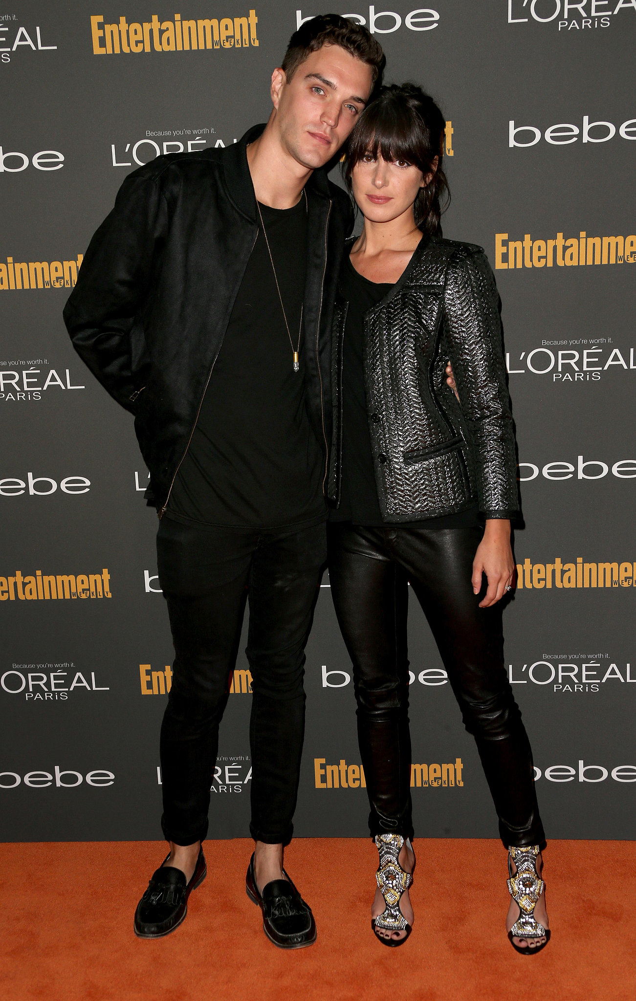Shenae Grimes posed with her husband in a black leather j