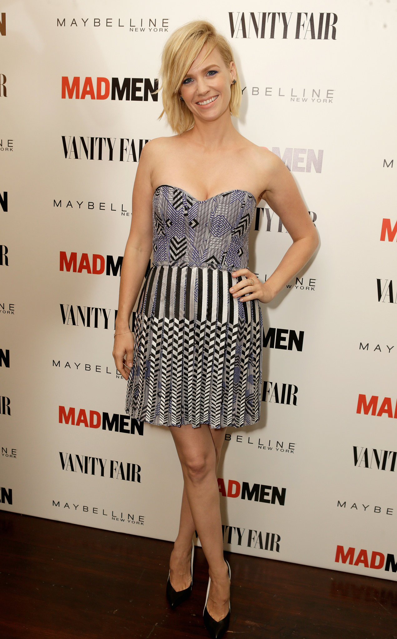 January Jones was flirty in a strapless number with mismatched prints at the Vanity Fair and Maybelline pre-Emmys party in honor of Mad Men.