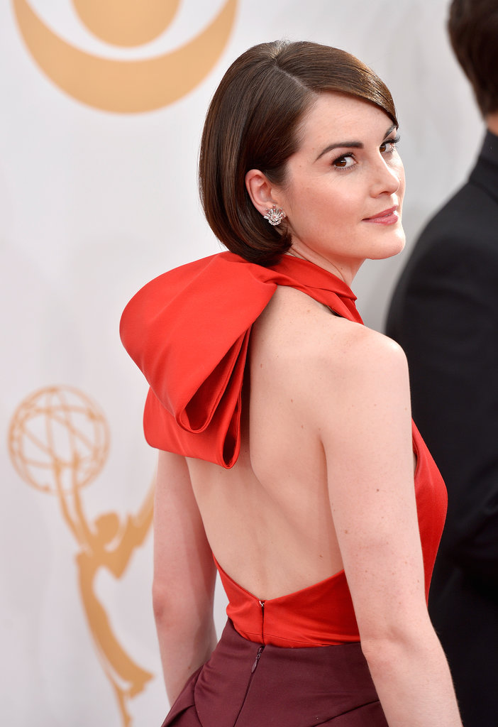 While we're used to seeing Michelle Dockery in '20s-era coifs on Downton Abbey, in everyday life she's often spotted in a sleek, mod hairstyle.