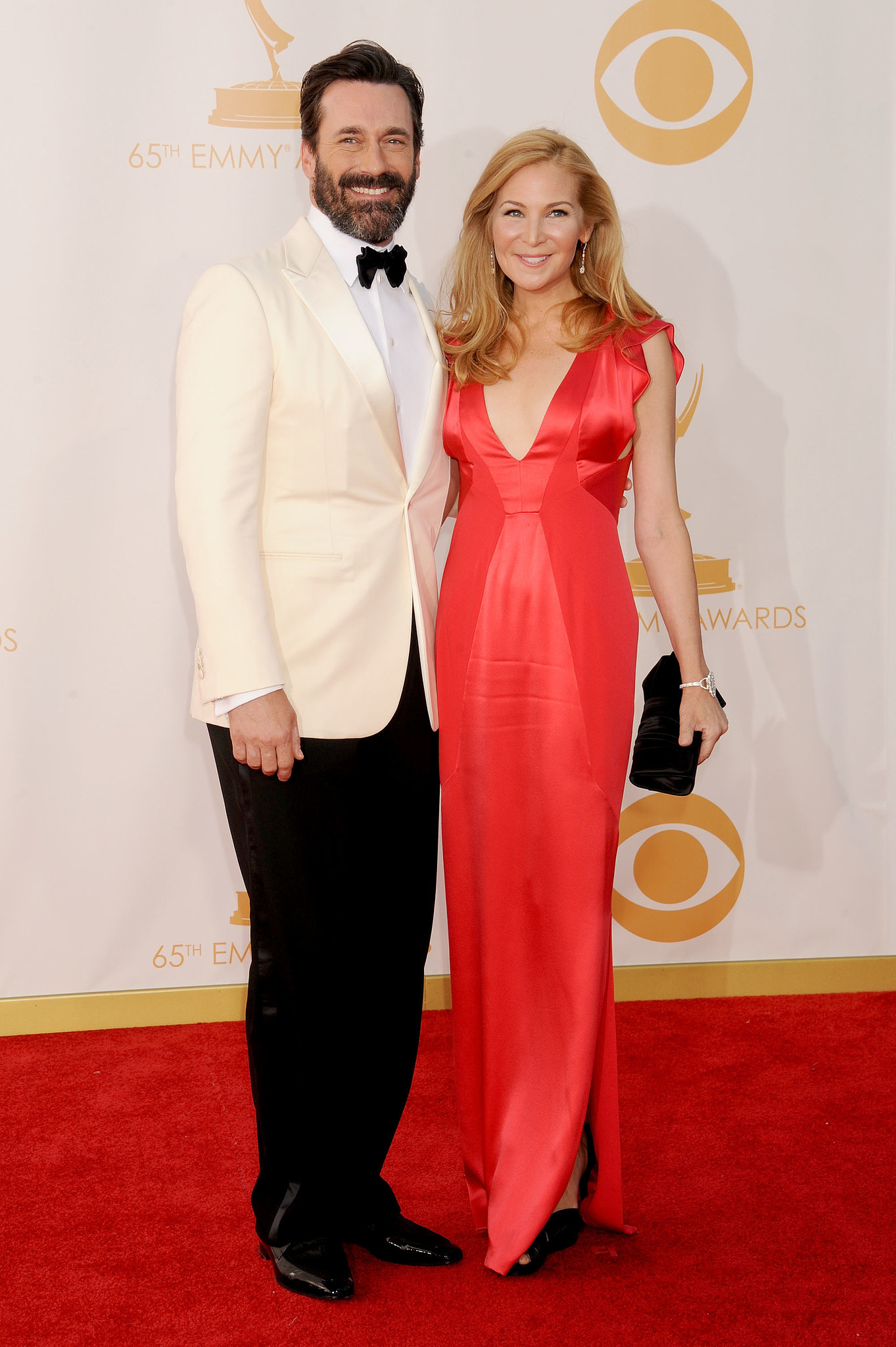 Jennifer Westfeldt arrived in a bright red gown with a dapper — and scruffy — John Hamm at her side.