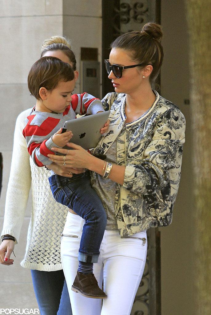 Miranda Kerr carried her son, Flynn Bloom.