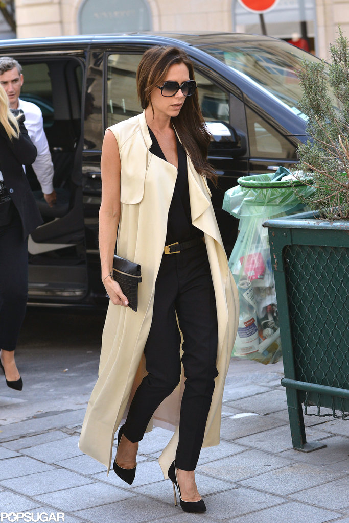 Victoria Beckham rocked a floor-length sleeveless trench coat after her handbag presentation.