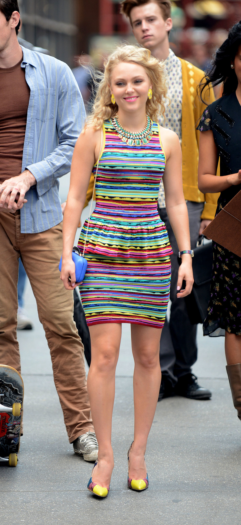 Carrie brightened the NYC street in a striped Torn by Ronny Kobo dress ($124, originally $248), featuring a sweet peplum detail and colorblock Aldo pumps.