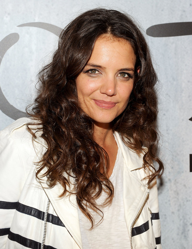 Katie Holmes opted for a curly mane with shimmering shades of gray on her lids and a pink gloss on her lips.