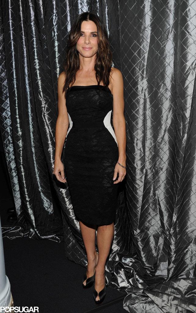 Sandra Bullock wore a black lace frock.