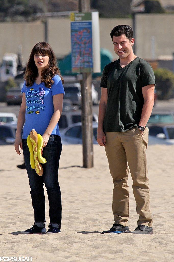 Max Greenfield and Zooey Deschanel filmed scenes on an LA beach.