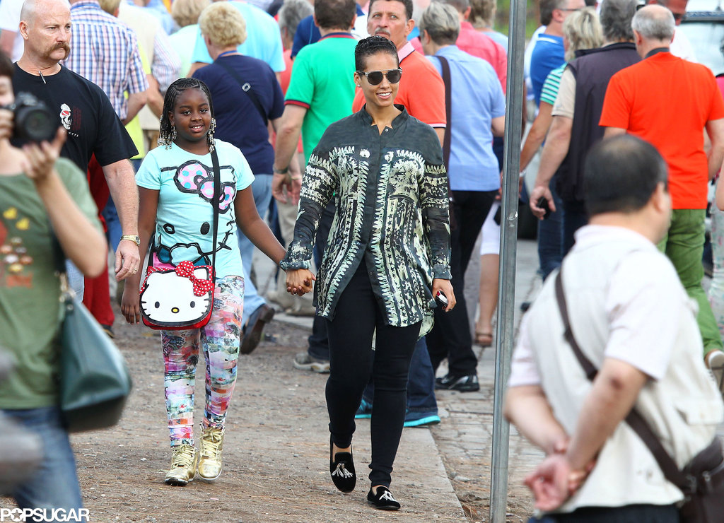 Alicia Keys walked hand in hand with her friend while on a Roman vacation.