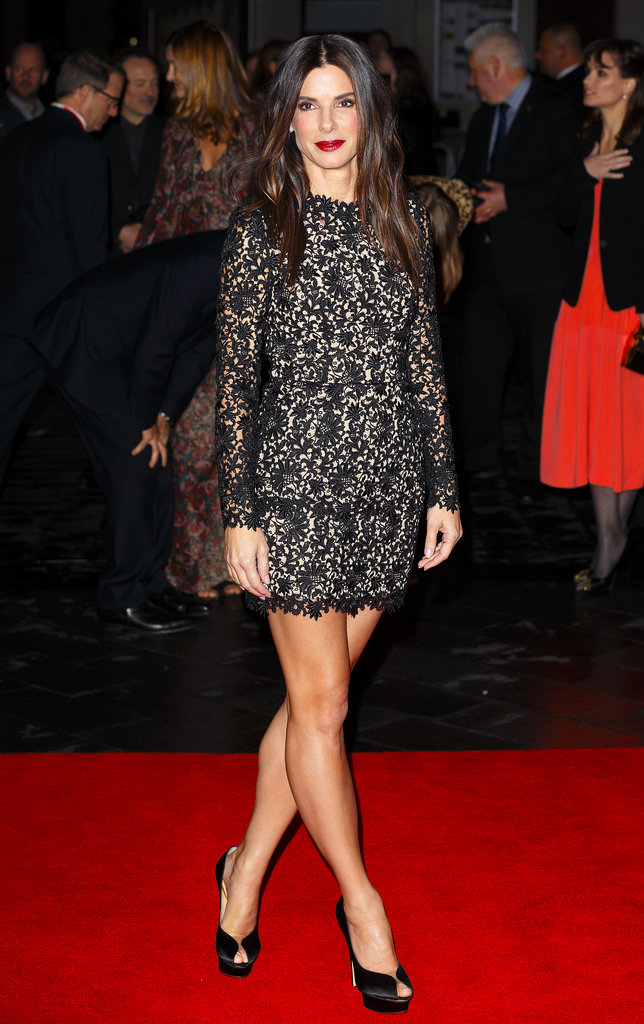 Still on her fashion-filled Gravity promotional run, Sandra Bullock really sizzled in a black lace skirt and top from Stella McCartney while in London.