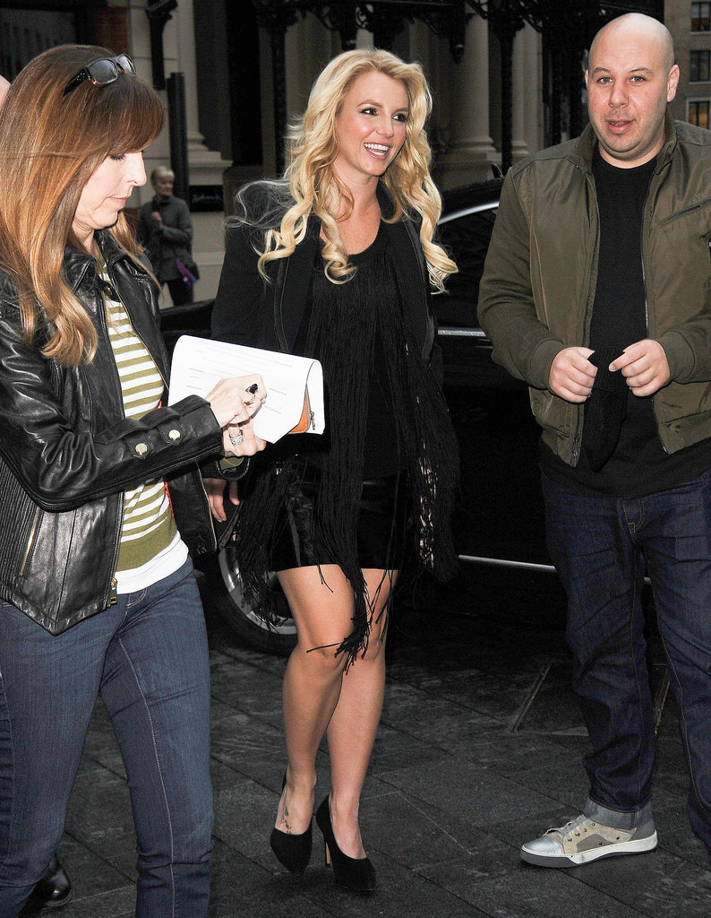 Britney Spears sported a short black dress and heels for her appearance on London's Capital FM radio station.