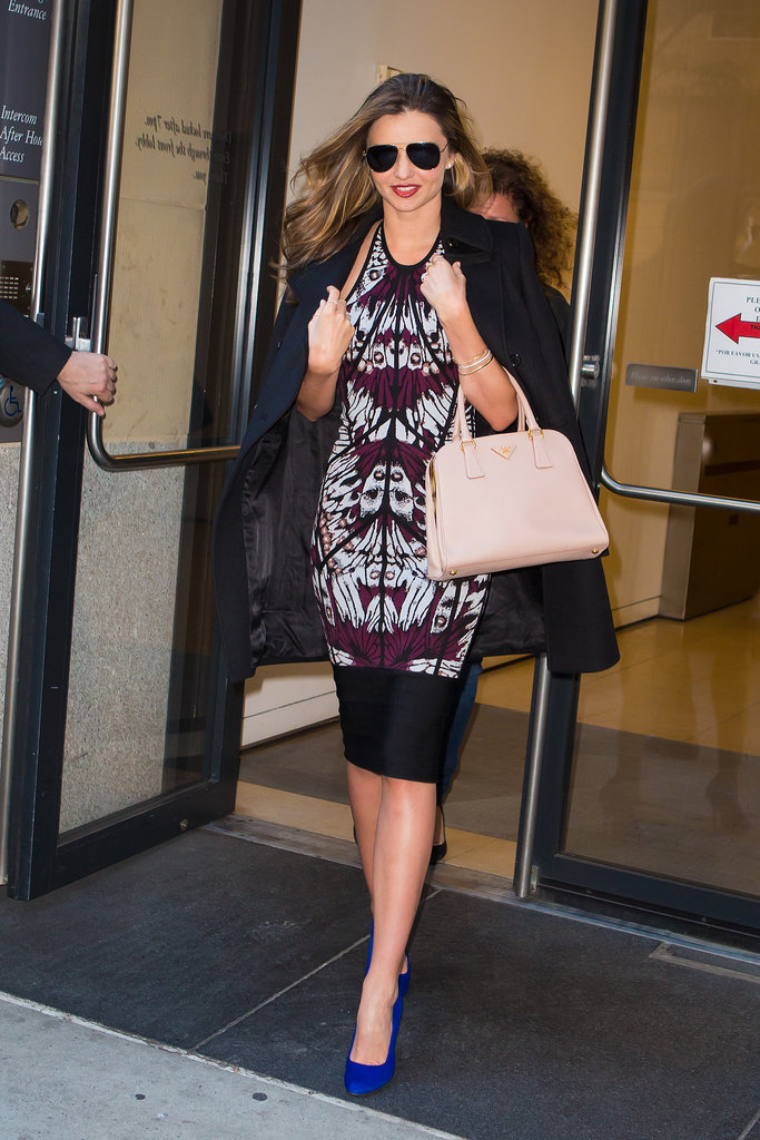 What accessory does Miranda tote on a shopping spree in NYC? A powder pink Prada bag, of course.