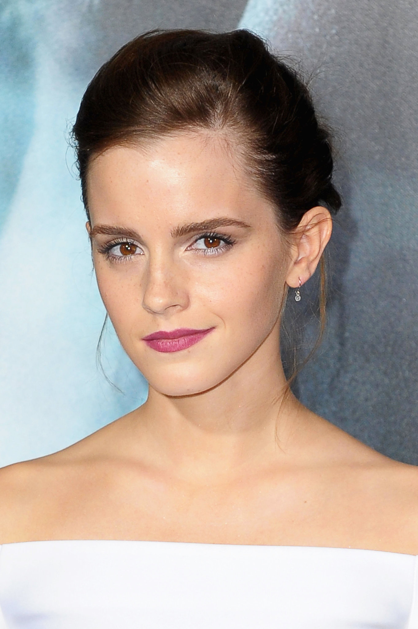 Emma Watson put her berry lips on full display with this updo.