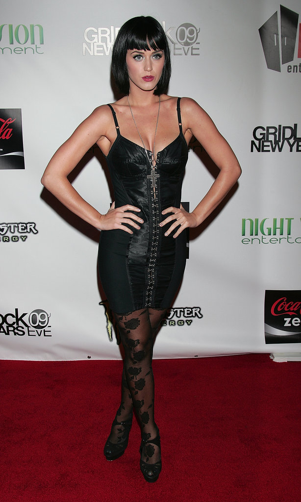 For NYE 2008, Perry channeled her inner vixen in a sultry corset minidress and lace tights, accessorized with a with a pendant cross and short black bob.