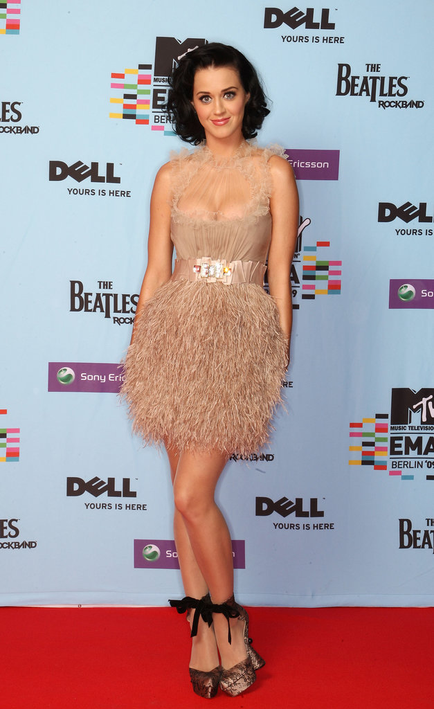 How adorable is this feathered Jenny Packham creation? We love how Perry's lace ankle-wrap pumps lent additional romance to her 2009 MTV Europe Music Awards look.