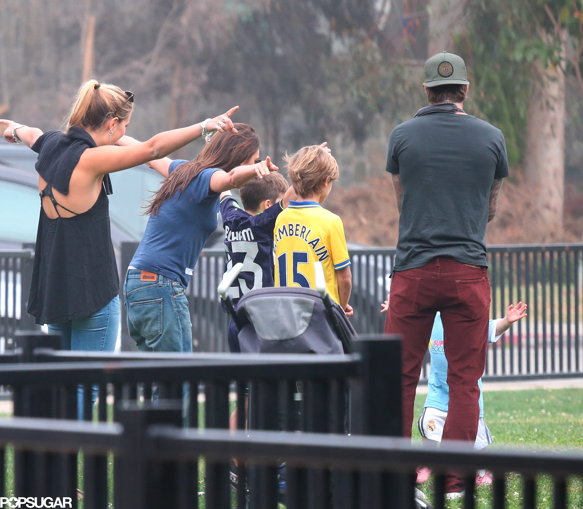 Victoria Beckham did soccer-mom duty while Harper played.
