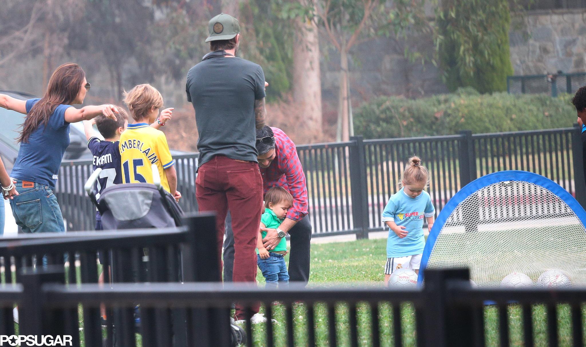 David Beckham and Victoria Beckham watched their daughter, Harper, play soccer.