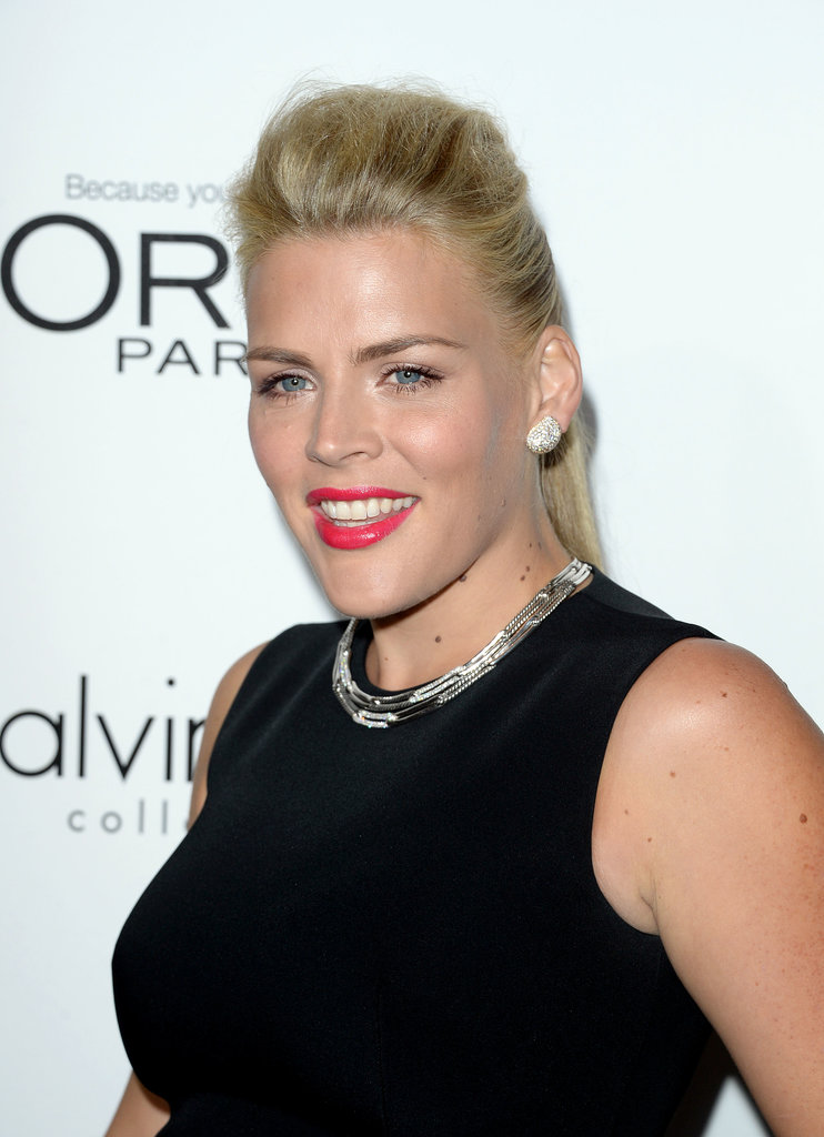 Busy Phillips wore a candy-apple red lip color the stood out almost as much as her pompadour and ponytail hairstyle.