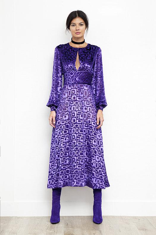 Geometric Devore Velvet Dress in Peacock Purple ($995), Sweet Revenge Stretch Suede Legging Boot in Purple ($2,395) Photo courtesy