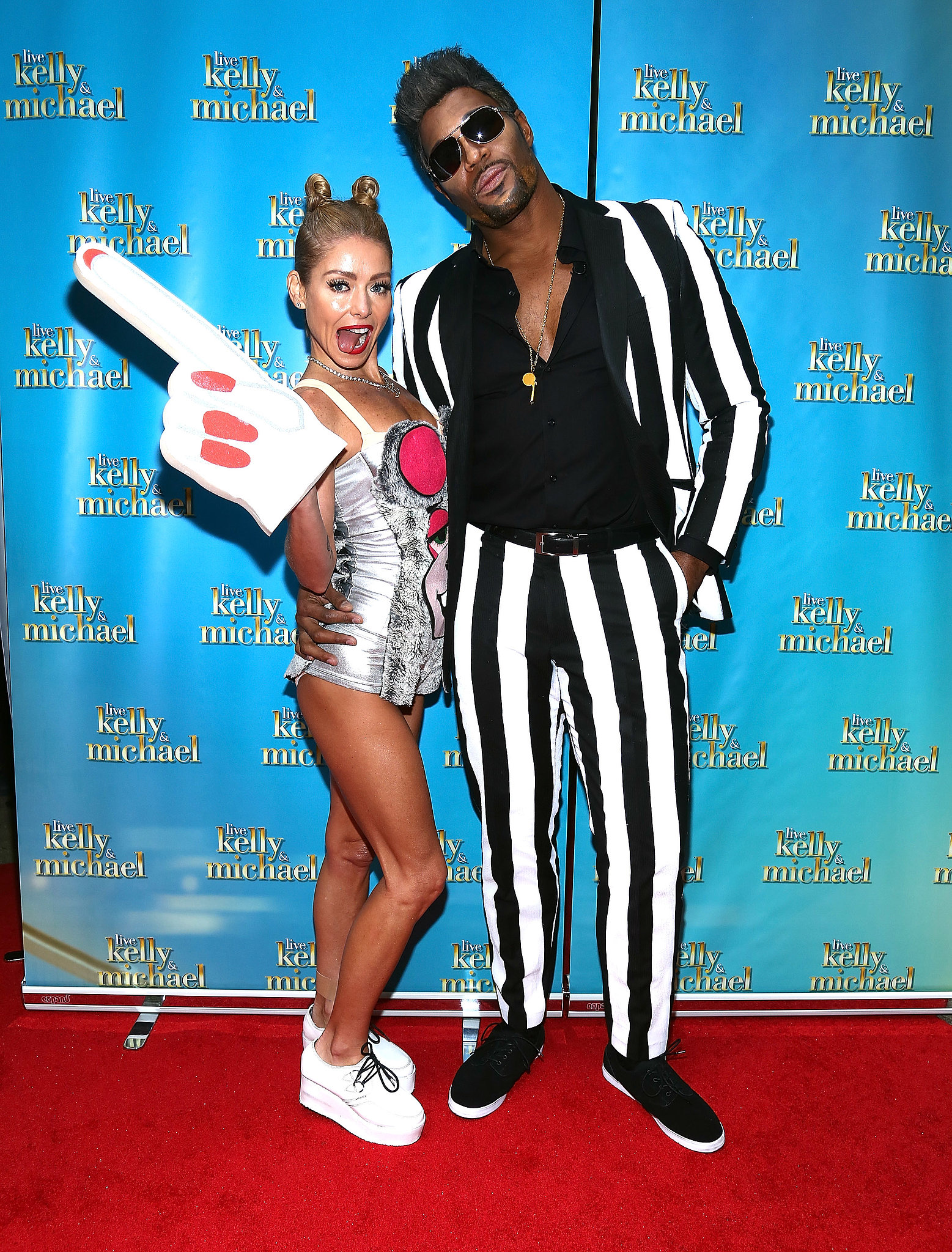 Kelly Ripa and Michael Strahan were Miley Cyrus and Robin Thicke for Halloween.