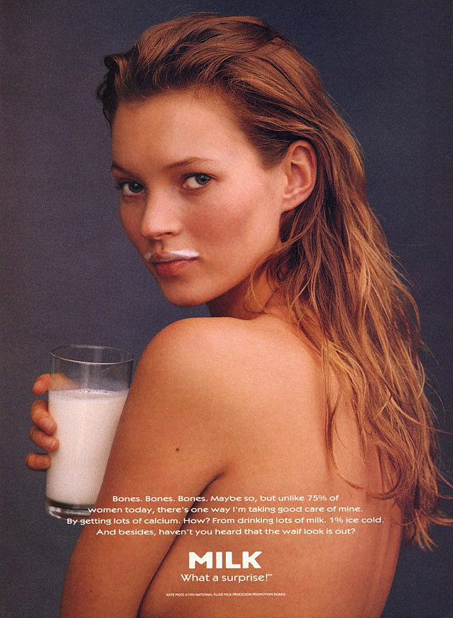 Kate Moss bared all, sporting just a milk mustache for her over-the-shoulder pose.
