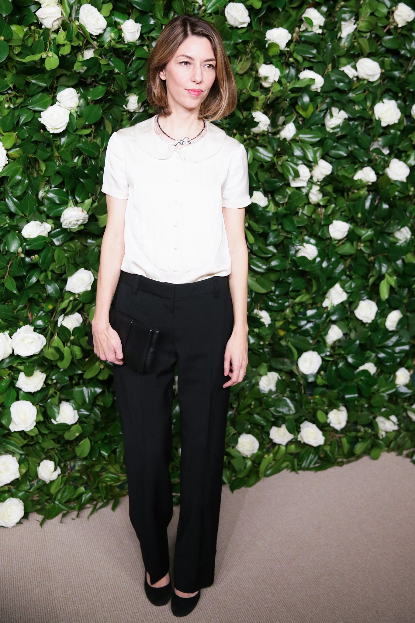 Sofia Coppola arrived for the MoMA Film Benefit in Chanel's blouse paired with the label's Lueur d'un Soir necklace.
