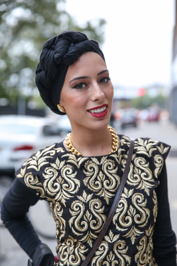 A good, bold lip and a twisted turban are a funky twist on holiday hair.