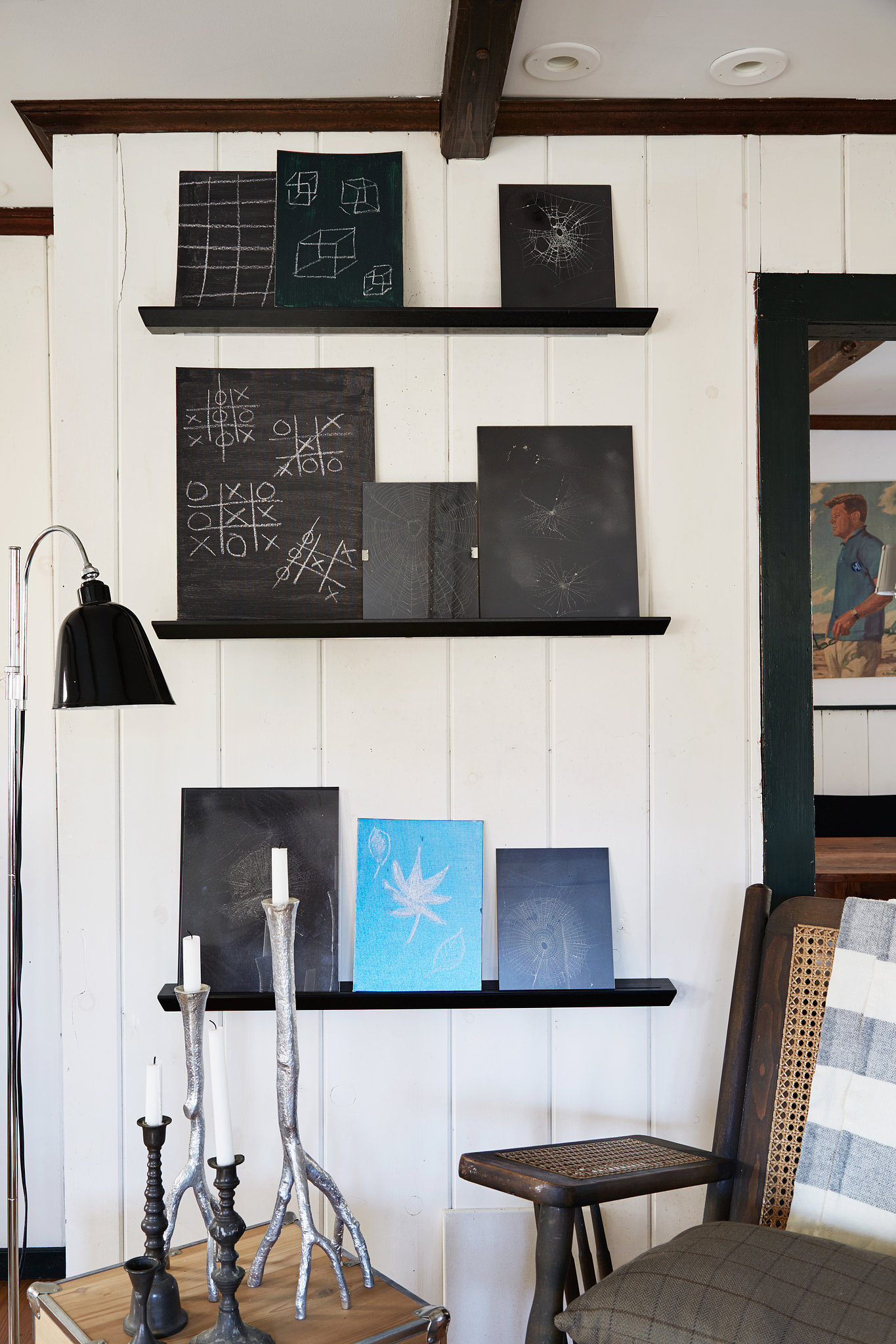 Floating shelves display Danny's ever-changing collection of chalkboard art. Photo by Armando Rafael Photography