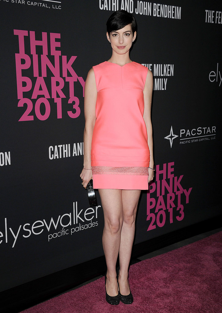 Hostess Anne Hathaway sported a melon-pink shift with a sheer band for Elyse Walker's Pink Party in October 2013.