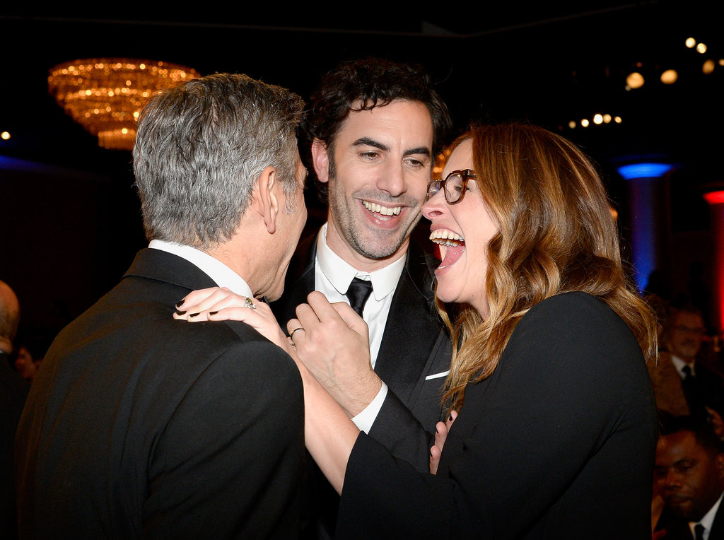 Julia Roberts laughed out loud while chatting with Sacha Baron Cohen and George Clooney.