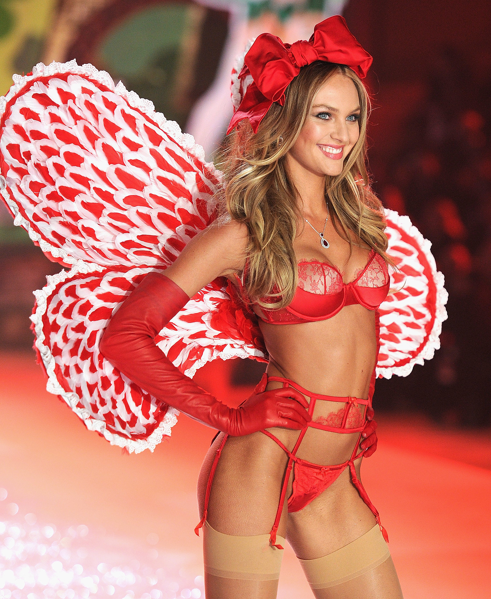 Candice Swanepoel smiled for the audience while walking the runway in 2012.