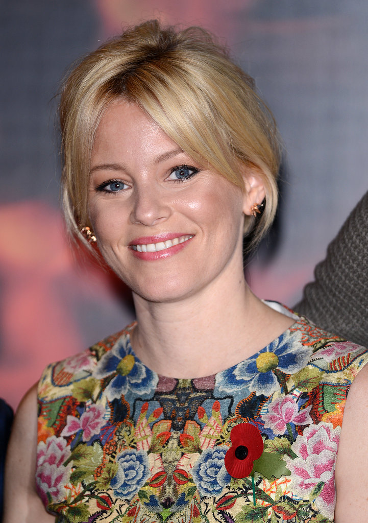 At a photocall before the world premiere, Elizabeth Banks stuck to pretty neutrals and swept her hair into a piecey updo.