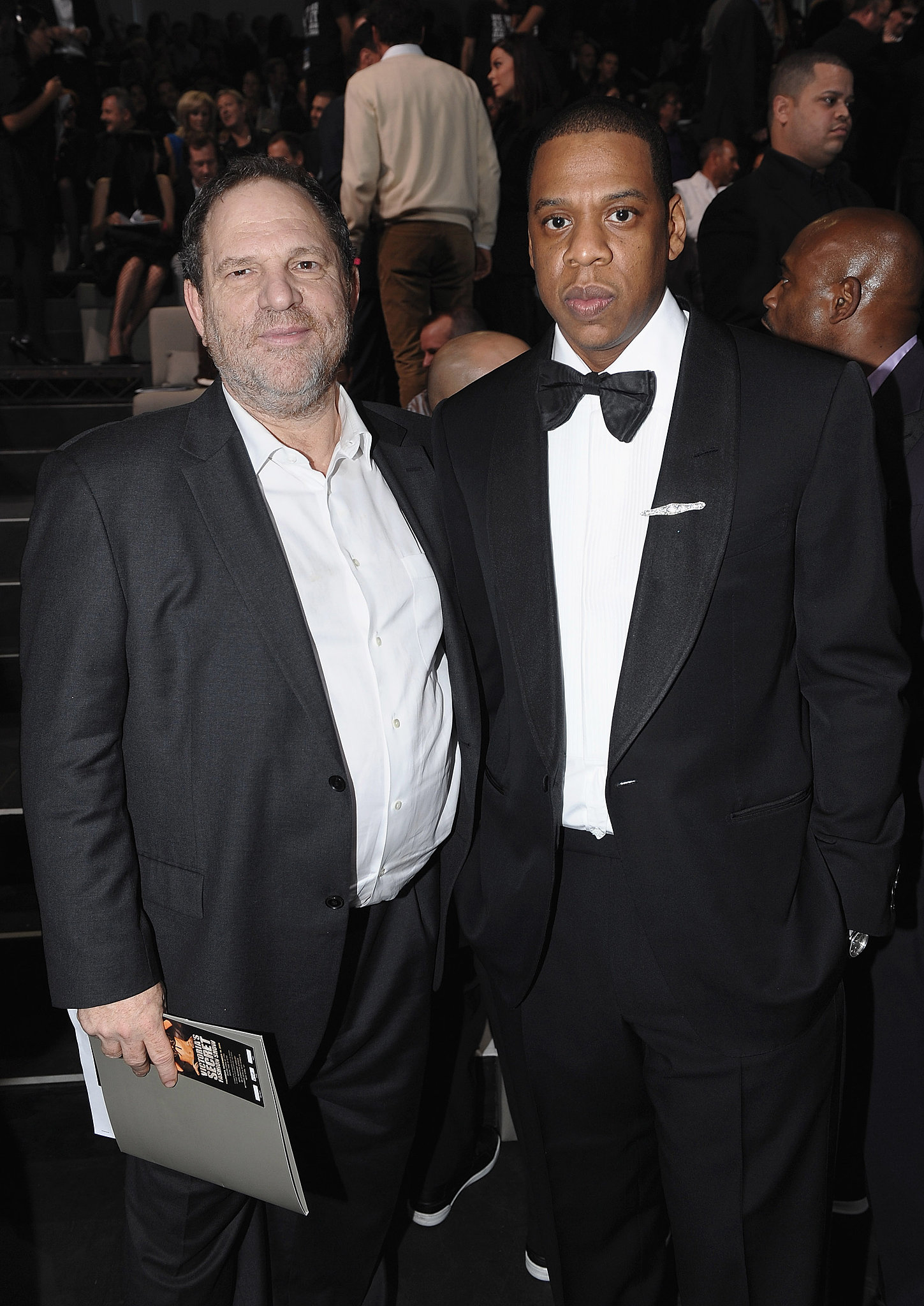 Harvey Weinstein and a bow tie-clad Jay-Z posed together before taking their seats in 2009.