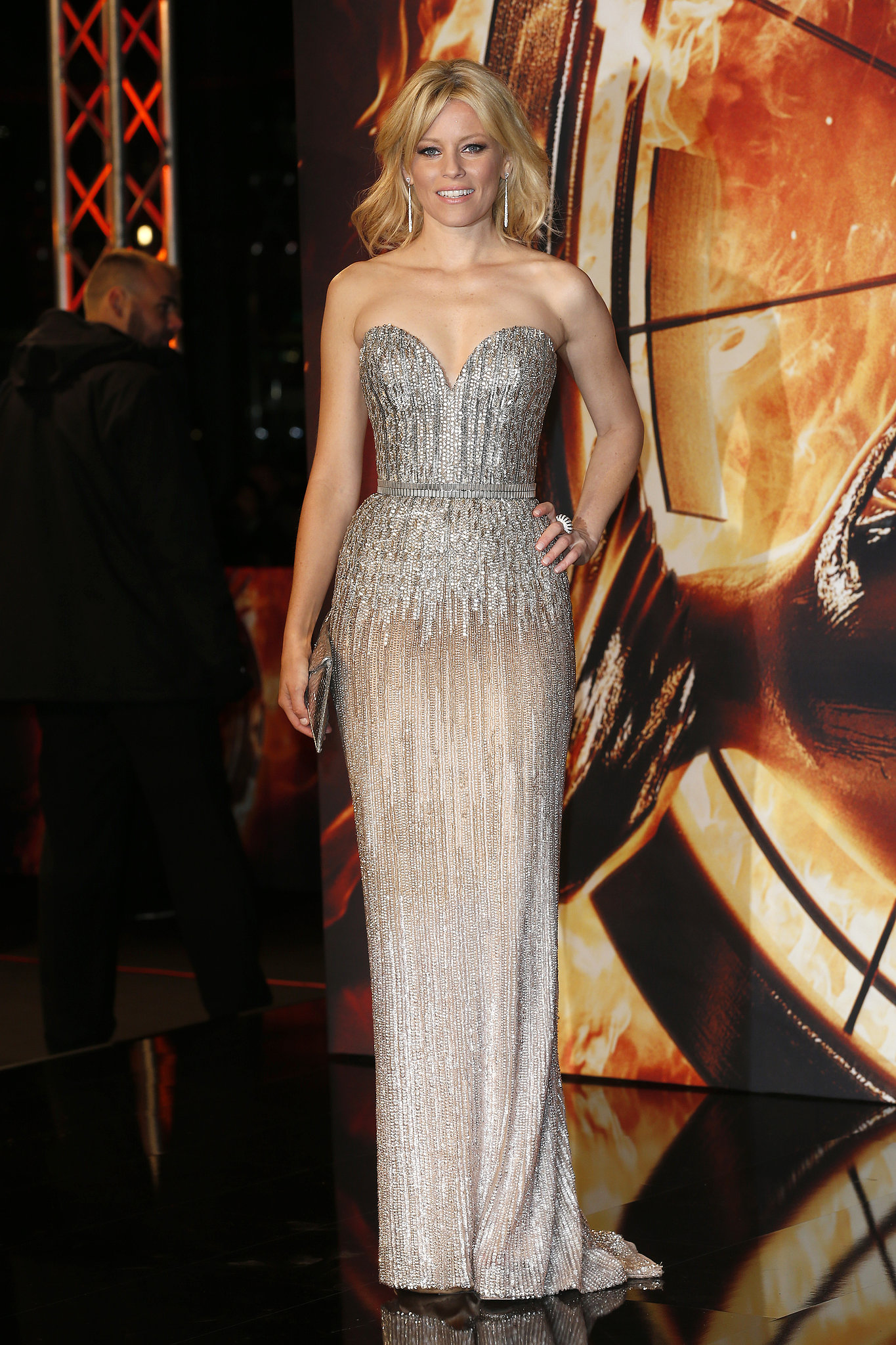 Elizabeth Banks shimmered in a strapless Elie Saab Haute Couture gown embellished with silvery sequins at the Germany premiere, paired with a Kara Ross clutch and Brian Atwood heels.