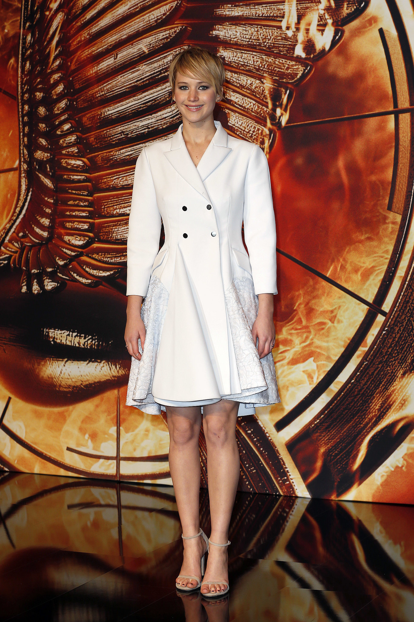 Jennifer Lawrence attended the Germany premiere wearing nothing but an ice blue coatdress by Dior and a pair of Stuart Weitzman sandals.