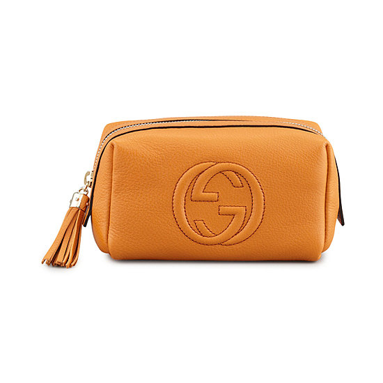 Orange leather and a playful tassel zipper make Gucci's leather case ($320) an instant classic.