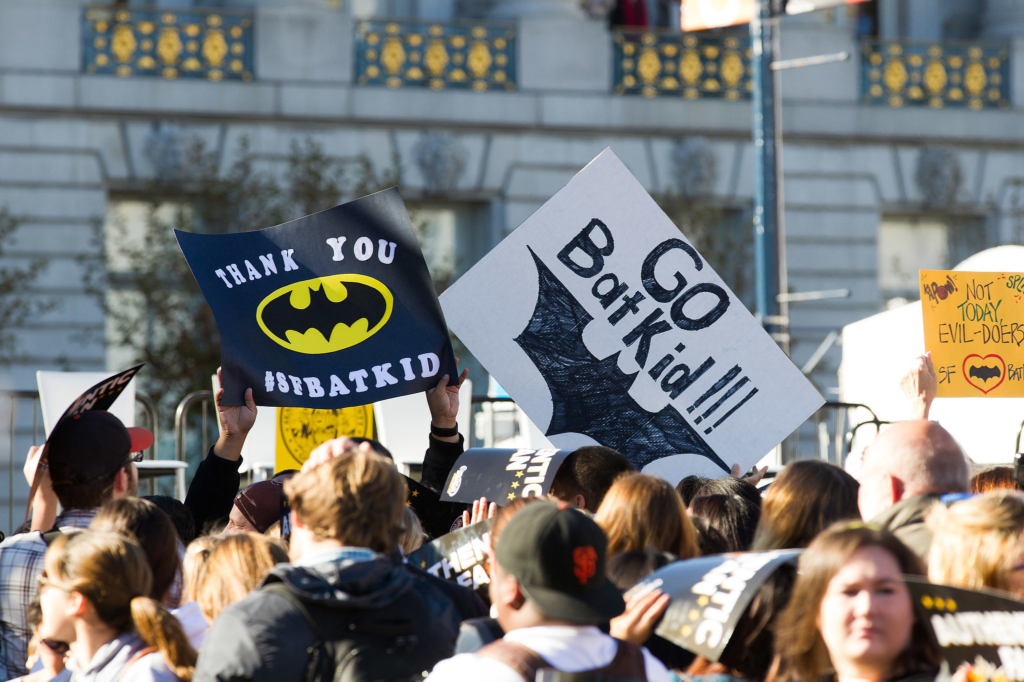 Signs for Batkid filled the crowd, which cheered as he arrived at City Hall.