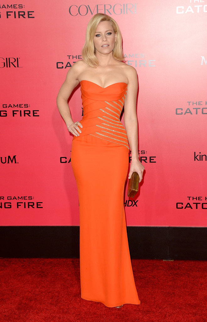 Elizabeth Banks upped the sex appeal in a curve-hugging, boldly-hued Versace gown. She picked up on its sparkling gold embellishment with a metallic box clutch and rings by Jennifer Fisher.