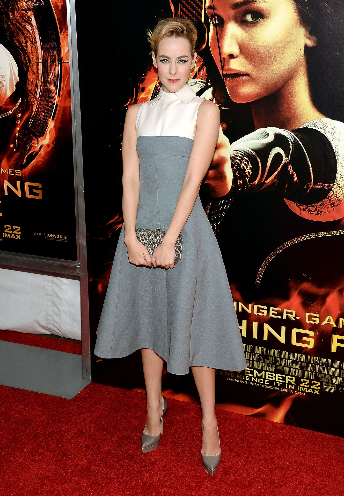 Jena Malone looked like a Hitchcock heroine in her Valentino gray and white fit-and-flare midi dress with Casadei pumps.