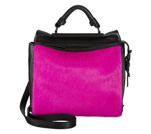 "Is a ""pursehorse"" a thing? If it is, I am one. This 3.1 Phillip Lim Ryder satchel ($1,095) in fuchsia ponyhair and black leather is the latest object of my affection. The color is intense, but the details and hardware are sleek and streamlined, making it the kind of gift any fashion-lover worth her mettle would gasp upon finding under the Christmas tree. — Lindsay Miller, entertainment editor"