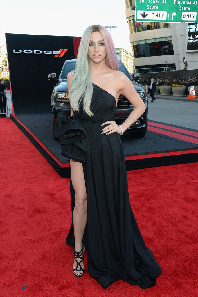 Ke$ha went for dark glamour in a satin, one-shouldered gown complete with a thigh-high slit and sexy caged shoes. We're not sure where the pastel locks come into play, but we like them!