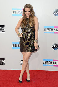 Alicia-Silverstone-put-her-gams-display-gold-metallic-mini