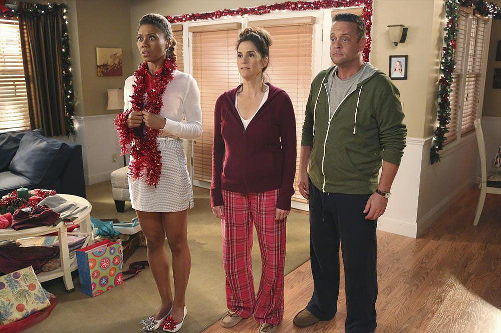 "The Neighbors Jackie (Toks Olagundoye), Debbie (Jami Gertz), and Marty (Lenny Venito) on The Neighbors' holiday episode, ""A Christmas Story,"" airing Dec. 13 on ABC."