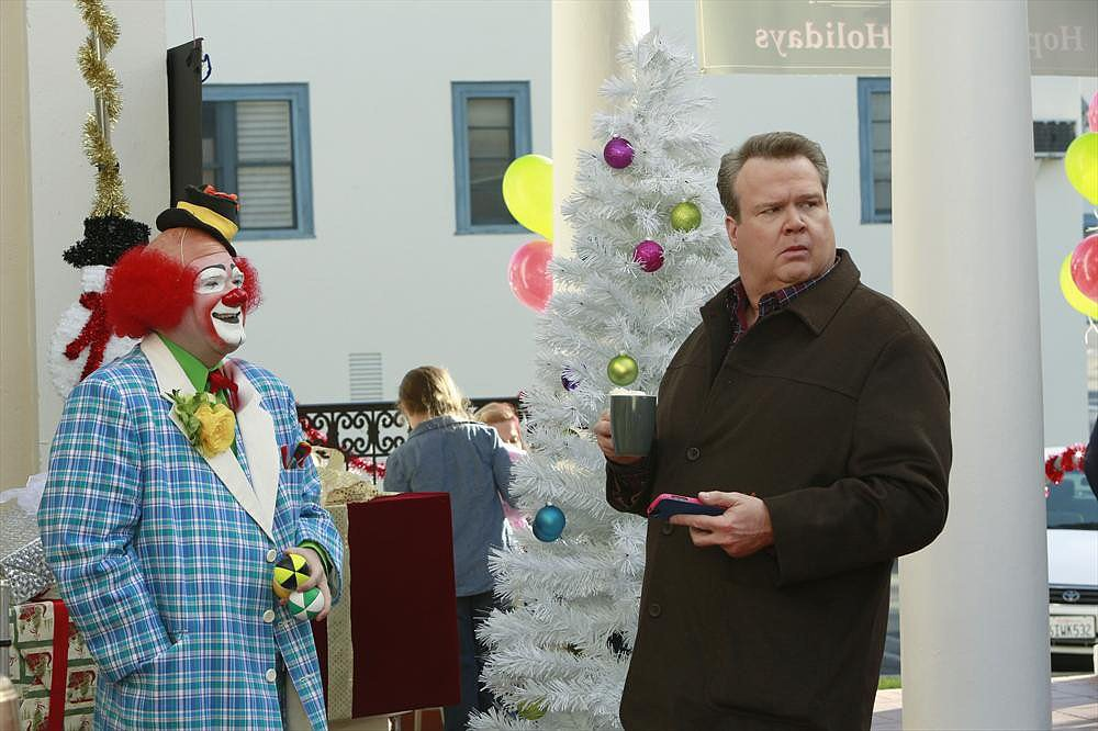"Modern Family Cam (Eric Stonestreet) goes to a charity event on Modern Family's holiday episode, ""The Old Man & The Tree,"" airing Dec. 11 on ABC."