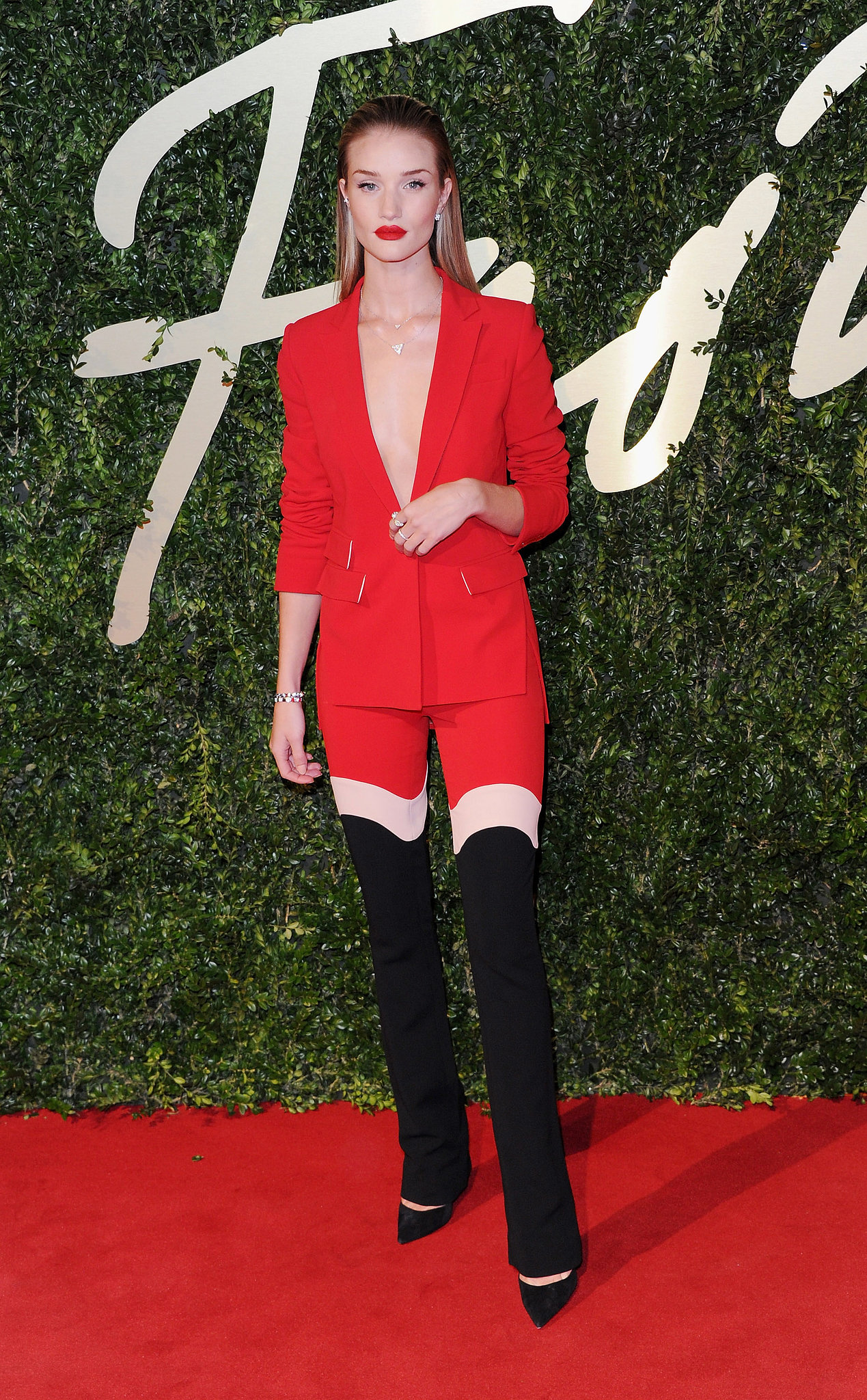 Rosie Huntington-Whiteley dared to be bold in a red ensemble with thigh-high boots.